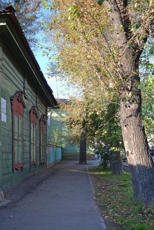 architectonics: The wooden house with closed window shutters on Irkutsk street in autumn Stock Photo