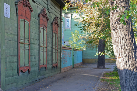 needle laces: The wooden house with closed window shutters on Irkutsk street in autumn Stock Photo
