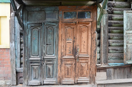 architectonics: The wooden dilapidated doors. Old entrances in Irkutsk. Russia Stock Photo