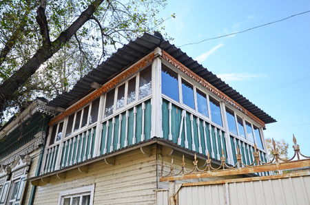 attic: Old two-storey wooden house with dlazed attic. Irkutsk streets, Russia