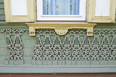 architectonics: The bottom part of window with shatters and old lacy wall.  Irkutsk streets, Russia