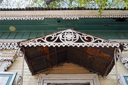 The carving decorative element of the entrance of the wooden house. Irkutsk streets