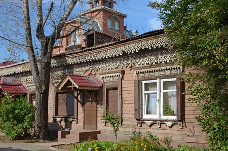 jalousie: Wooden house with beauty carving and modern jalousie on Irkutsk street, Russia Stock Photo