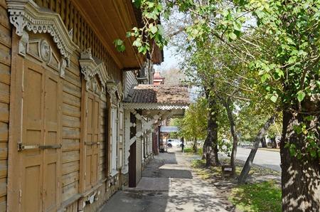 The wooden house with closed window shutters on Irkutsk street, Russia