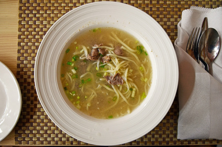 mongolian: Traditional Mongolian cuisine. Soup with homemade nuddles and lamb meat