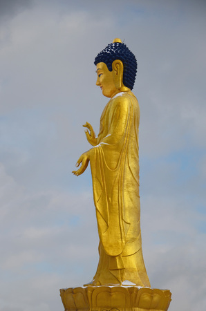 clody sky: Ulaanbaatar, Mongolia - Dec 02 2015: Golden Buddha statue near the hill Zaisan in Ulaanbaatar Editorial