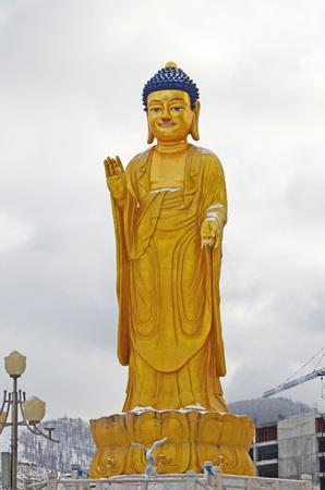 clody: Ulaanbaatar, Mongolia - Dec 02 2015: Golden Buddha statue near the hill Zaisan in Ulaanbaatar Editorial