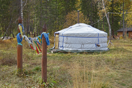 nomadic: Nomadic yurt for tourists on hiking trail camp in autumn forest