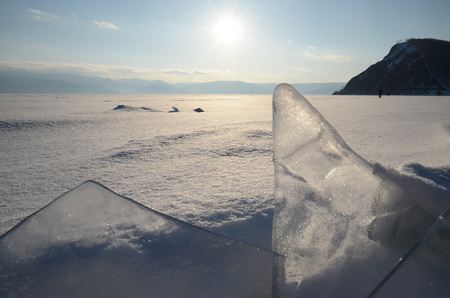 ice floes: Thin transparent ice floes against the sunset light. Hummocks on Baikal Stock Photo