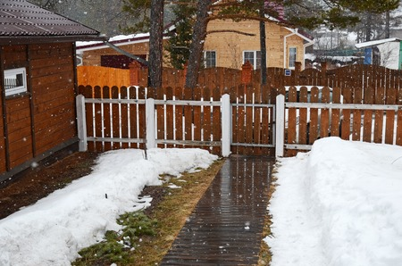 sleet: Spring sleet in the village. Inner yard of country house Siberia, Russia