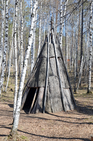 dwelling: Irkutsk region,RU-May,10 2015: Pole chum - portable dwelling in a conical shape, covered with bark. Tofalar camp. Museum of Wooden Architecture Taltsy