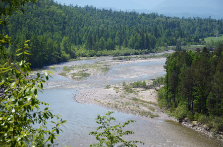 riverbed: Curved riverbed of Irkut River in its beginning in the Sayan Mountains in sunny day