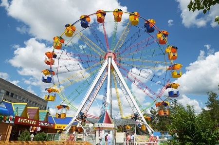 Chita, RU - Jul.17,2014: Ferris wheel in summer park of culture and recreation in the city of Chita, Russia