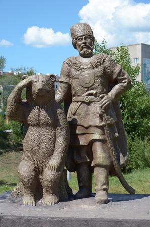 Chita, RU - Jul17 2014: Sulpture The Cossack and the Bear in Odori Park in the city of Chita, Transbaikalia edge, Russia