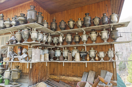 traditionally russian: A large number of antique samovars on the shelves