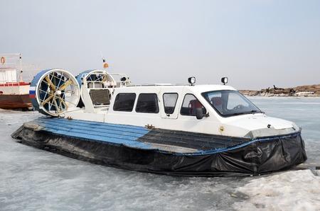 Hovercraft, vessel for for movement on the ice, on the dock in Large Goloustnoye Village. Baikal Lake
