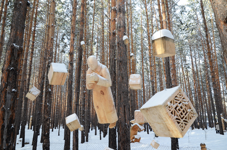 Irkutsk Region,Ru-Jan, 03 2015: The composition of hanging figures. Park of wooden sculptures in Savvateevka Village