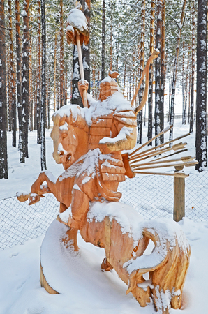 Irkutsk Region,Ru-Jan, 03 2015: Hercules on horseback. Park of wooden sculptures in Savvateevka Village