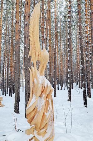 Irkutsk Region,Ru-Jan, 03 2015: Fairy forest bird. Park of wooden sculptures in Savvateevka Village Editorial