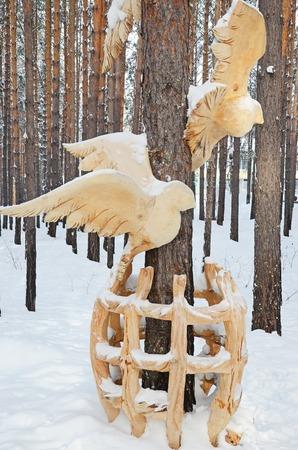 Irkutsk Region,Ru-Jan, 03 2015: Birds out of cage. Park of wooden sculptures in Savvateevka Village