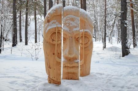 Irkutsk Region,Ru-Jan, 03 2015: Face of three parts. Park of wooden sculptures in Savvateevka Village