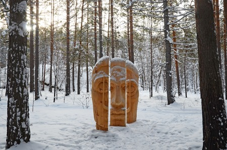 Irkutsk Region,Ru-Jan, 03 2015: Face of three parts. Park of wooden sculptures in Savvateevka Village