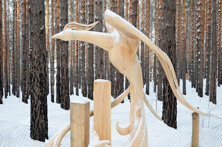 Irkutsk Region,Ru-Jan, 03 2015: Fairy forest bird. Park of wooden sculptures in Savvateevka Village Editorial