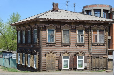 A two-storey wooden house with carved ornaments n the city of Irkutsk
