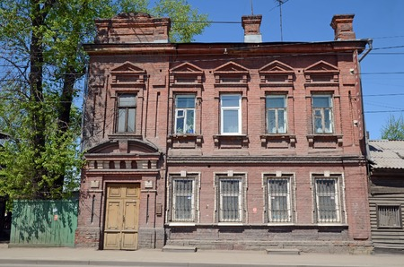 Old two-storey brick house in the center of Irkutsk.