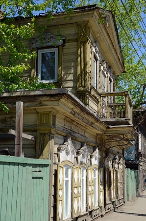 Old two-storey wooden house with a mezzanine in the center of Irkutsk.