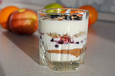 bawl: Healthy yogurt with mix of berry, sunflower seeds, bran and honey for healthy morning meal. Selective focus Stock Photo