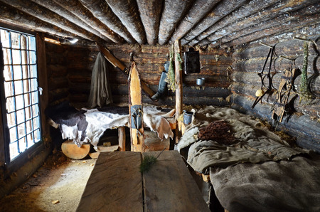 Irkutsk region,Russia-Feb,18 2017: Interior of the Hunting hut in Museum of Wooden Architecture Taltsy