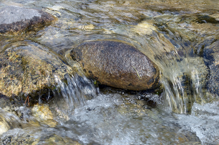 rages: Little seething mountain clear river with big stones