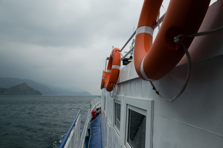Ship goes on Baikal in cloudy weather