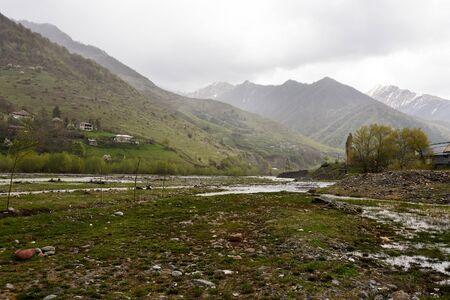 Aragvi River valley and mountains of Caucasian ridge in rainy day, Georgia