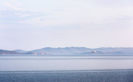 Amphibian aircraft during refueling by water to extinguish forest fires in Irkutsk Region. Lake Baikal