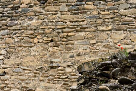 Stone wall - fencing territory Svetitskhoveli Cathedral. Stone texture
