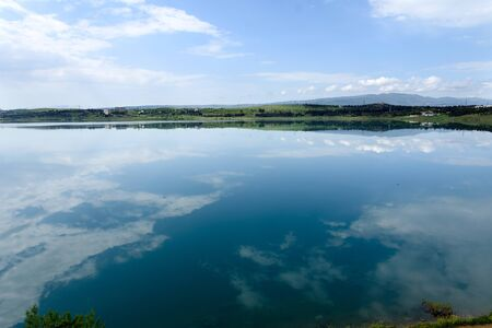Smooth surface of Tbilisi reservoir water in morning of sunny spring day 写真素材