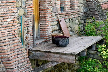 Old bowler basket door brick wall monastery backyard, Georgia