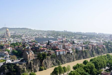 Top view on Kura river and Avlabari district in center of Tbilisi at sunny day, Georgia 写真素材 - 135103584