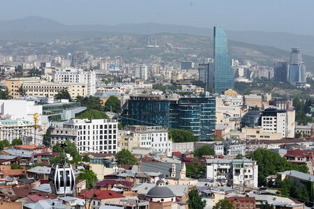 Top view on center of Tbilisi with modern buildings at sunny day, Georgia