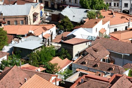 Top view on Old Tbilisi with red tiled roofs at sunny day, Georgia
