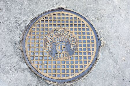 Tbilisi, Georgia-May, 07 2019: Manhole with georgian letters on Tbilisi street. Georgia 写真素材 - 135109770