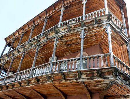 Traditional wooden carved balconies of residential building in center of Tbilisi, Georgia 写真素材 - 134617913