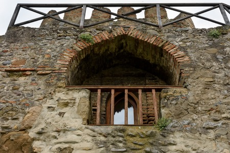 Tbilisi, Georgia-May,6 2019: Svetitskhoveli Cathedral in Mtskheta ancient capital Georgia. Part of fortress wall with small window and balcony