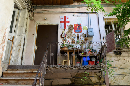 Tbilisi, Georgia - May, 08 2019: Porch of residential building with flag of Georgia and many cute homemade crafts, Georgia