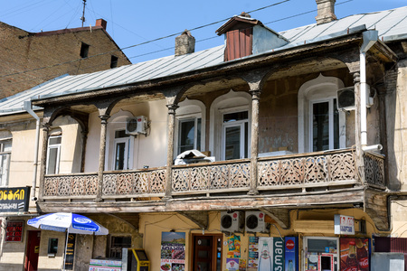 Tbilisi, Georgia - May, 08 2019: Traditional wooden carved balconie of residential building in center of Tbilisi, Georgia