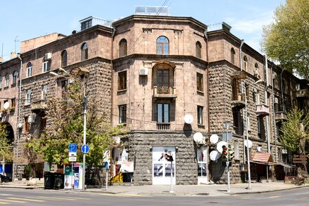 Residential building in center of Yerevan, built of traditional pink tuff - volcanic rock, Armenia 写真素材