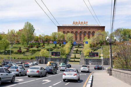 Yerevan, Armenia-April, 28 2019: road over Victory Bridge and facade of Yerevan Brandy Factory, Armenias leading alcoholic beverage company, Yerevan