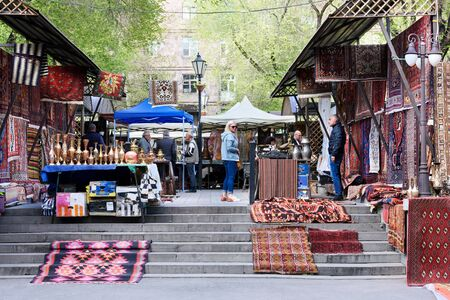 Yerevan, Armenia-April, 28 2019: Rows with traditional Armenian rugs on Vernissage flea market in center of Yerevan, Armenia